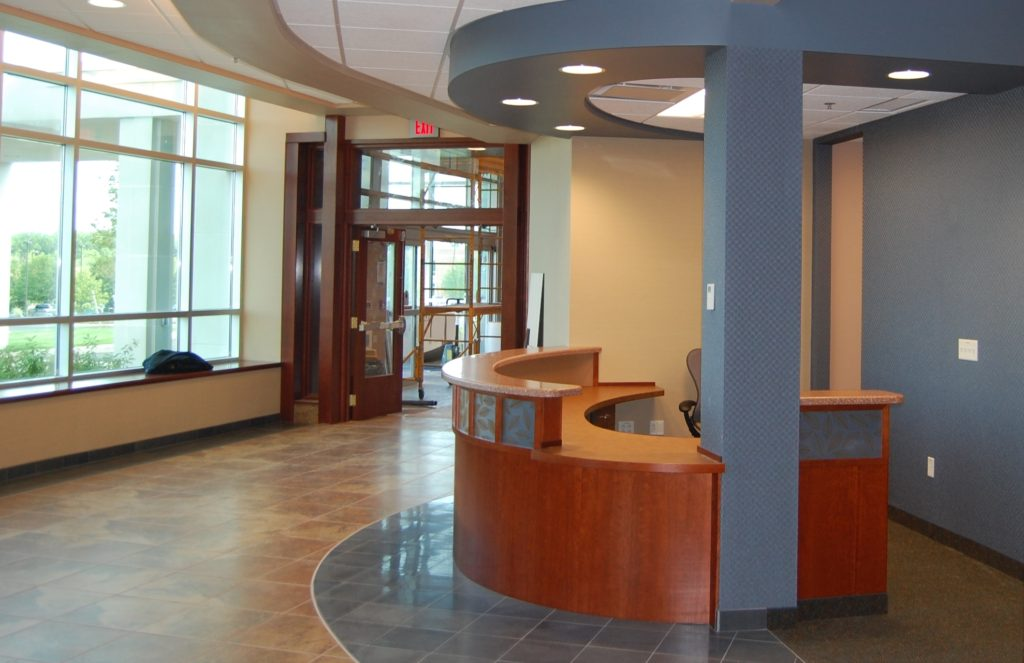 custom reception desk – Strong Ambulatory Center – Hanlon Architects